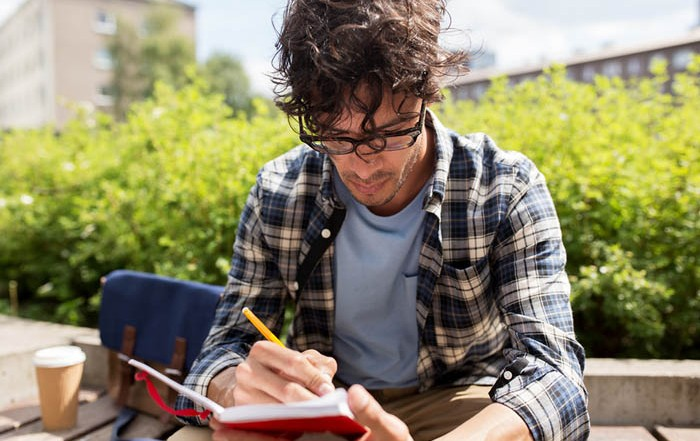 Young man journaling: Creative Writing in the Metaphysical Field